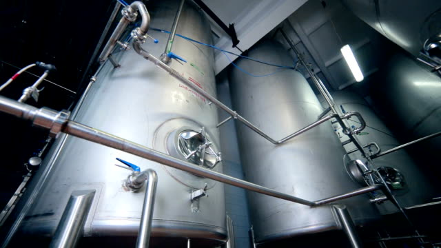 Shiny stainless steel tanks for alcohol distillation and storage video