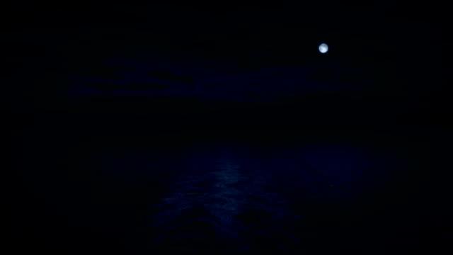ship back view at night with moon - oceano atlantico video stock e b–roll