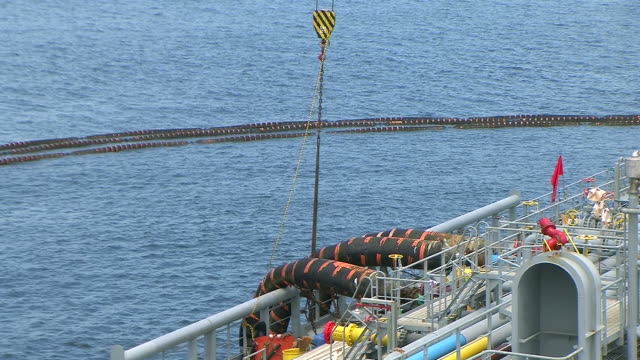 Ship bunkering Ship bunkering at sea. pipe connector stock videos & royalty-free footage