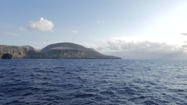 Ship cruising volcano island, San Benedicto video
