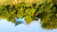 istock Ship made from paper swimming on water surface 1331175925