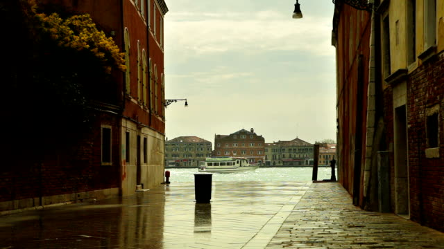 Ship passes by one of the canals in Venice, Italy video