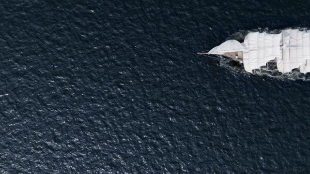 Ship sailing in rough seas aerial top view