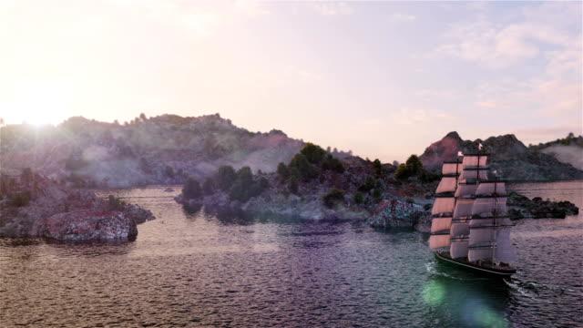 fartyget seglar i sjögång flygfoto på solnedgången och bergen bakgrund - segelfartyg bildbanksvideor och videomaterial från bakom kulisserna