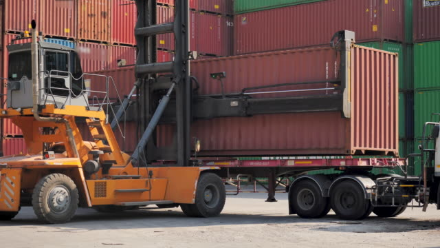 shipping container loader truck transporting box. - port wine stock videos & royalty-free footage