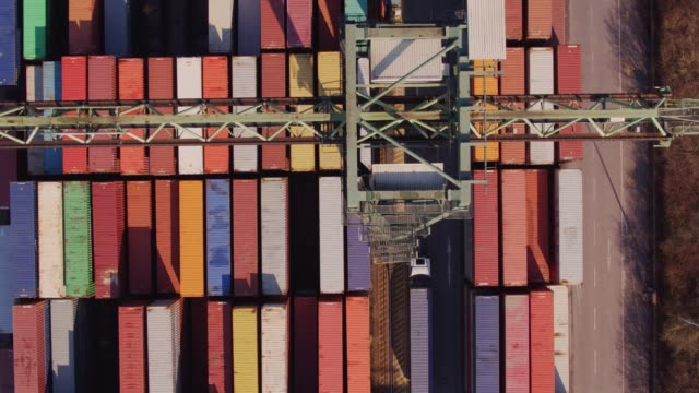 Shipping Containers Beneath Straddle Carrier video