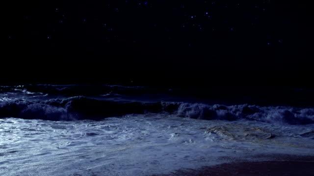 Ship's light at night on the sea.