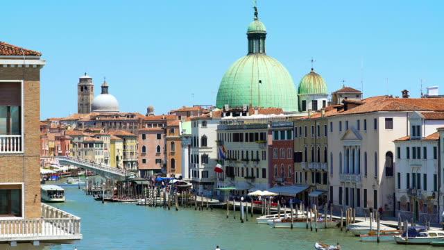 Ships sailing Grand Canal in Venice, view of San Simeone Piccolo church, travel video