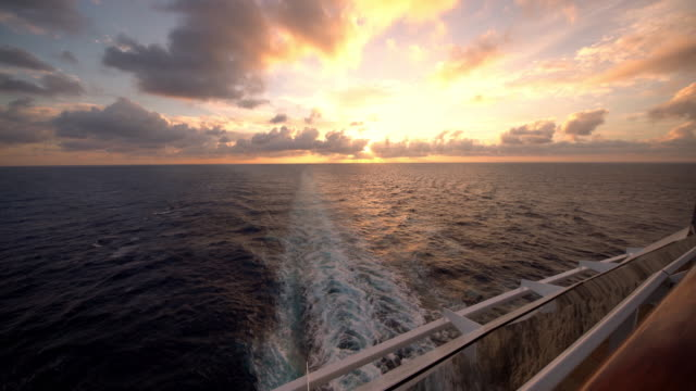 ws ship's wake at sunset - cruise video stock e b–roll