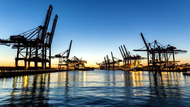Shipyard in Hamburg at sunset, time lapse Shipyard in Hamburg at sunset construction machinery stock videos & royalty-free footage