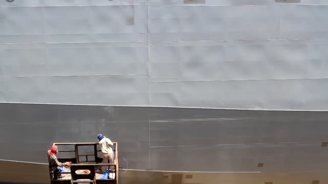 Shipyard worker paint the ship video