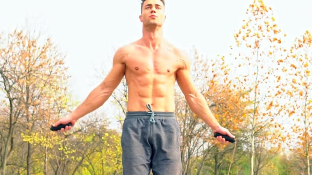 Shirtless man practicing on a jumping rope video
