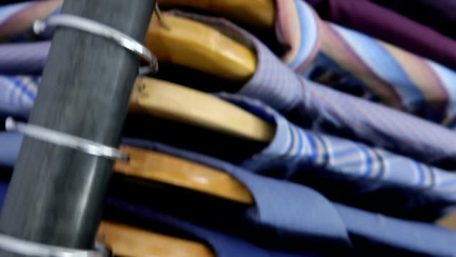 Shirts on hangers - Stock video White, Blue and Red Classic Male Shirts coathanger stock videos & royalty-free footage