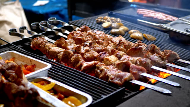 Shish Kebab Cooked on the Grill on the Street Market