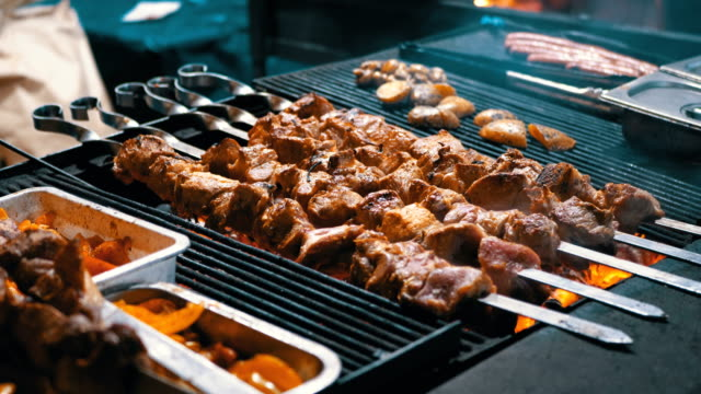 Shish Kebab Cooked on the Grill on the Street Market Shish Kebab Cooked on the Grill on the Street Market. Street food. Meat grilled on skewers. Barbecue party. skewer stock videos & royalty-free footage