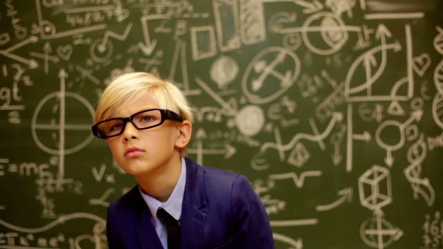 Shock teenage boy behind a blackboard with telescope Shock teenage boy behind a blackboard with telescope genius stock videos & royalty-free footage