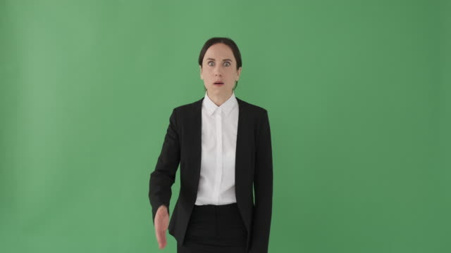 Shocked businesswoman covering mouth with hands
