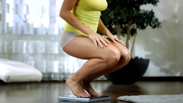 HD DOLLY: Shocked Woman Looking At Her Weight video