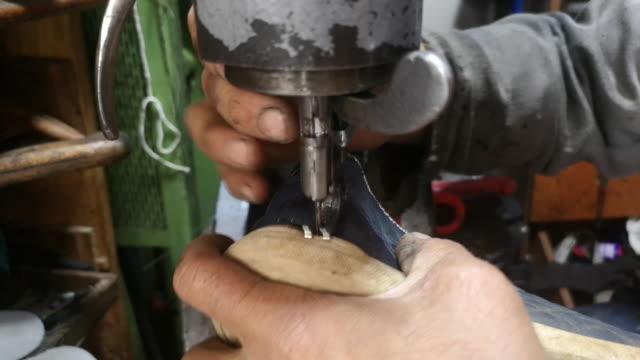 shoe maker is repairing shoe - scarpe video stock e b–roll