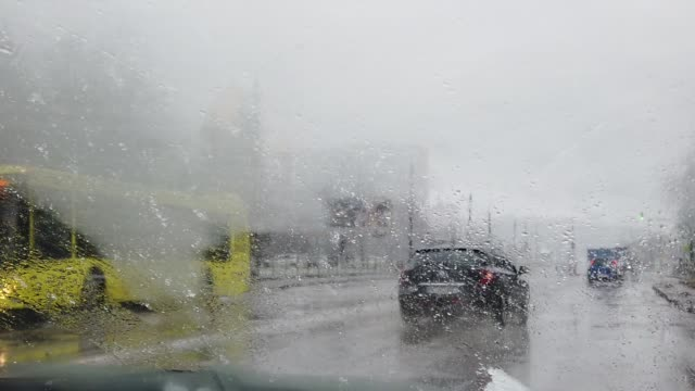 Shooting from a car during blizzard. Slow motion. video