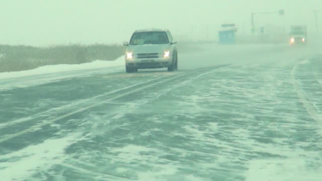 shooting from the cab when driving on a winter road in Siberia, in snowy weather shooting from the cab when driving on a winter road in Siberia, in snowy weather siberia stock videos & royalty-free footage