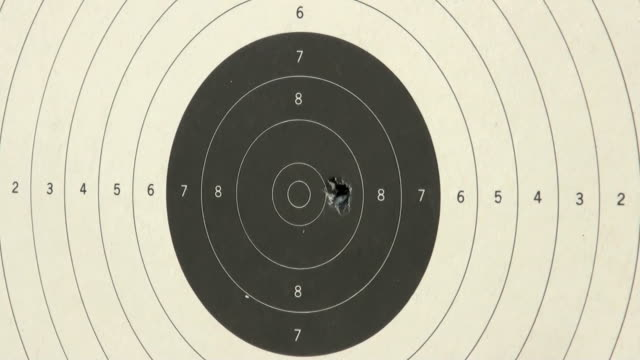 Shooting handgun pistol at target range. Shooting handgun pistol at target range. Target closeup. gun stock videos & royalty-free footage