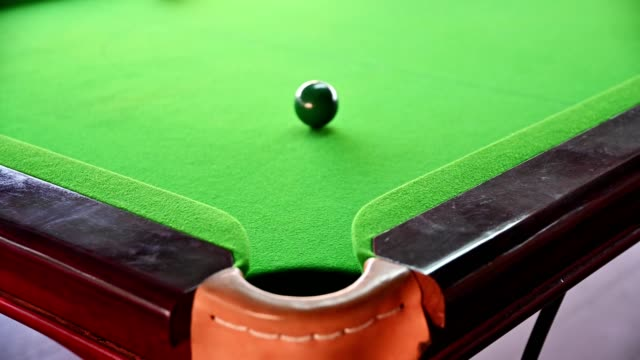 Shooting miss snooker in bar with color snooker ball
