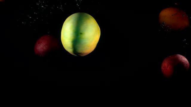 shooting of falling mango and maracuya in the water - video di passiflora video stock e b–roll
