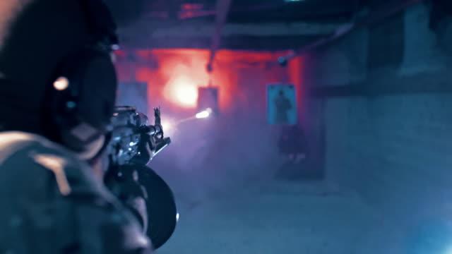 shooting range training. blowing the target - стрелять стоковые видео и кадры b-roll