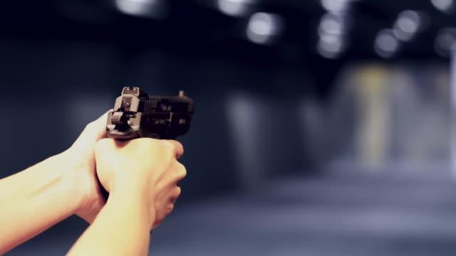 shooting with gun at target in shooting range - огнестрельное оружие стоковые видео и кадры b-roll