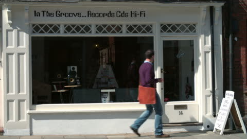 Shop owner opening up record, CD and hi-fi shop Shop owner opening up record, CD and hi-fi shop store stock videos & royalty-free footage