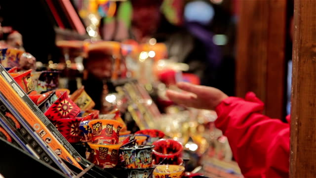 Shoppers Exchange Money at German Christmas Market Toy Stall - Twinkling Lights video
