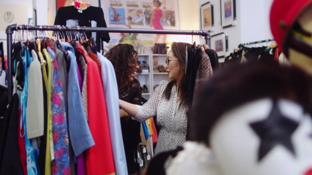 Shoppers Looking through Rack of Vintage Clothes video