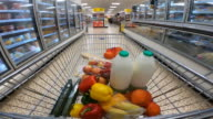 istock Shoppers point of view moving through supermarket aisle. 1271586574