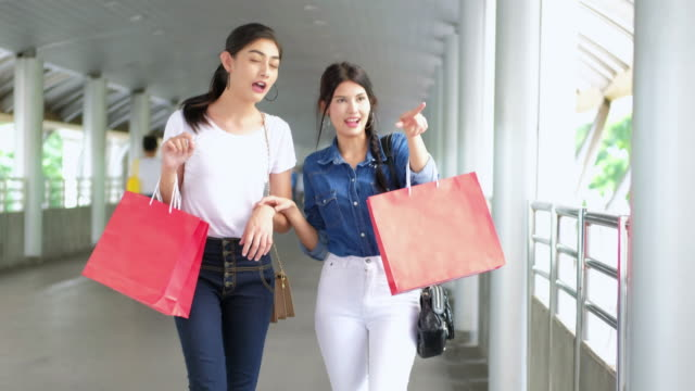 SEA: Shopping : 4K : Best friends shopping looking in the bag. video