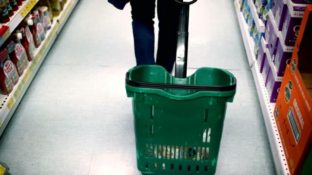 shopping basket-sale,consumerism concept-b roll - prodotti supermercato video stock e b–roll
