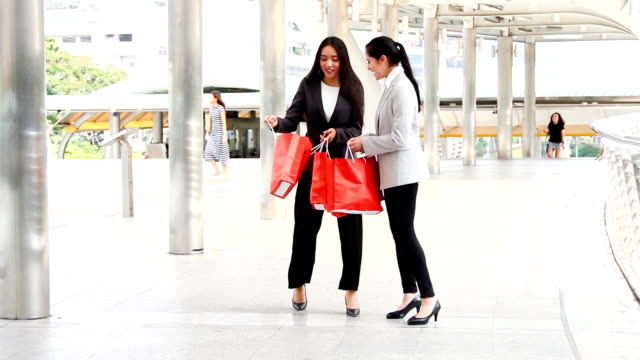 SEA: Shopping : Best friends shopping looking in the bag HD format. video