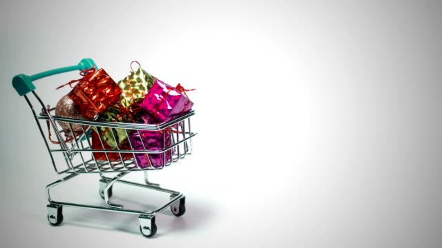 Shopping cart filled with gift boxes