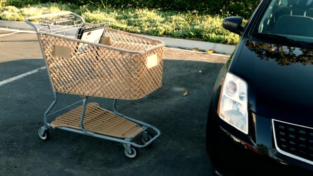 Shopping cart slams into car video
