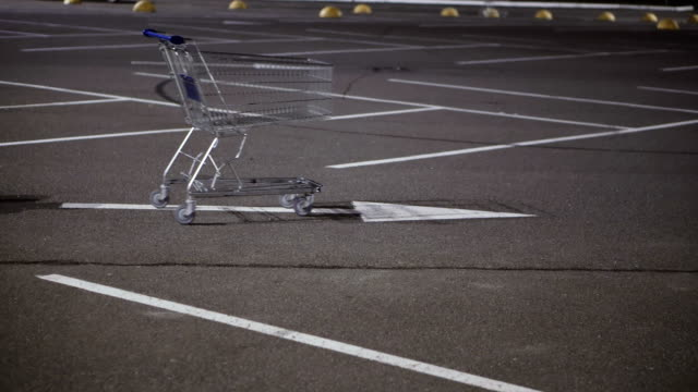 Shopping cart stands in the car parking Shopping cart stands in the car parking market retail space stock videos & royalty-free footage