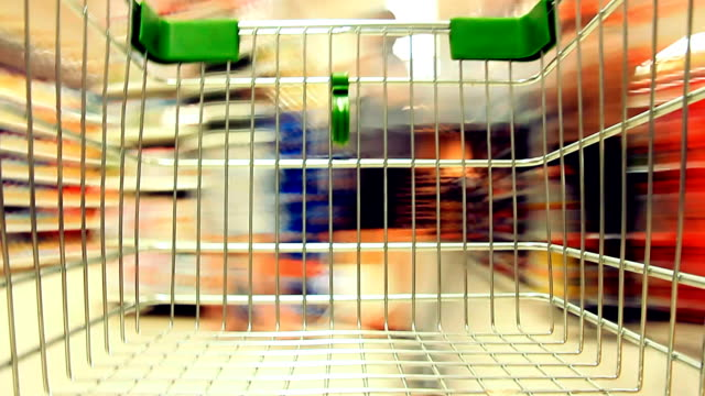 Shopping Cart view of Grocery time lapse. HD 1080P : Motion Grocery Cart  Time Lapse in Supermarket. shopping cart stock videos & royalty-free footage