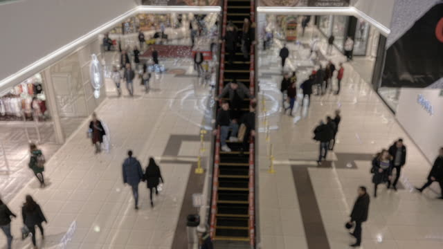 Shopping centre interior as blurred background. Wide angle. Slow motion. video