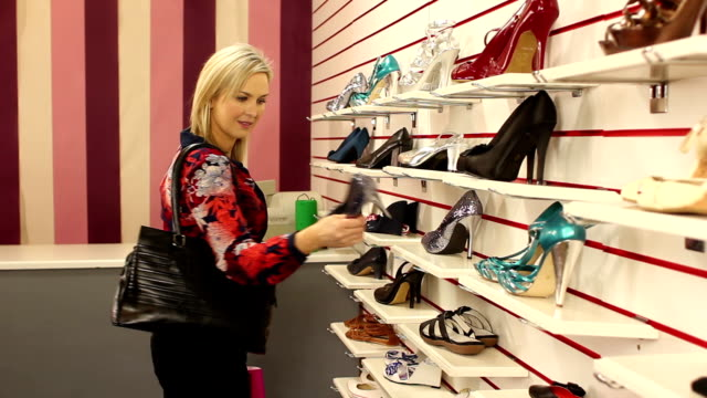 Shopping for shoes in a shop / store video