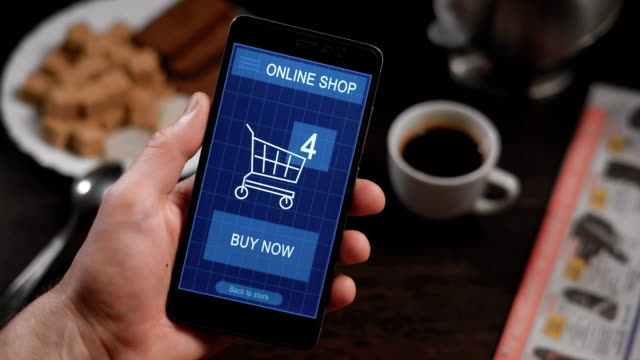 Shopping in an online store on your smartphone. The man has already chosen the goods, they are in the virtual basket, the finger presses the button to pay now, the transaction is successful video