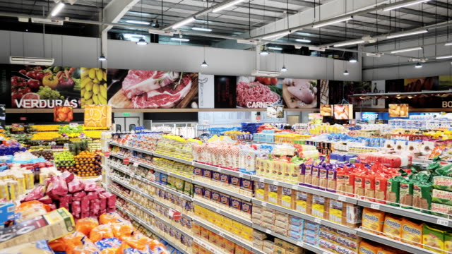 Shopping in supermarket in Latin America Shopping in supermarket in Latin America grocery aisle stock videos & royalty-free footage