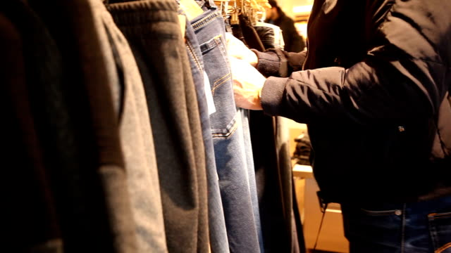 Shopping man in clothing store