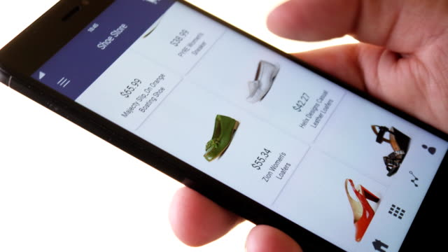 Shopping online using smartphone app and choosing shoes