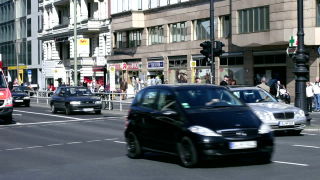 Shopping street with many people and cars video