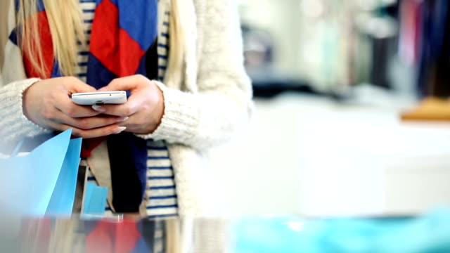 Shopping woman using a Smartphone video