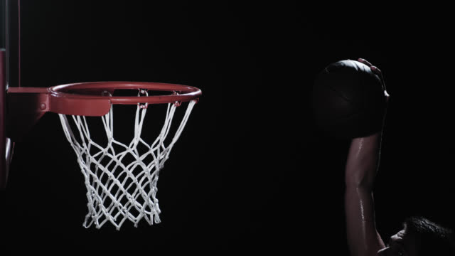 SLO MO shot of a basketball player performing the slam dunk video